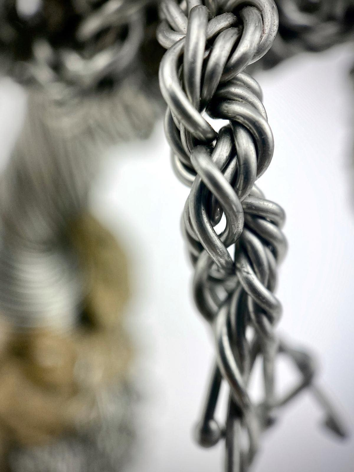 staying-strong-wire-tree-sculpture-twisting-wire-by-weaam-hassan